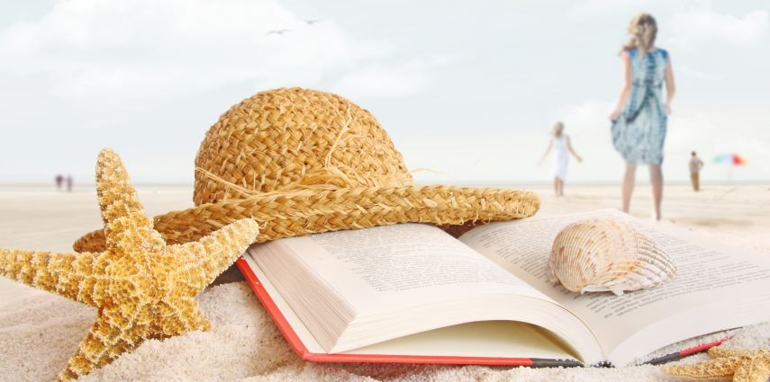 <p>Straw hat , book and seashells on the beach with people walking</p>