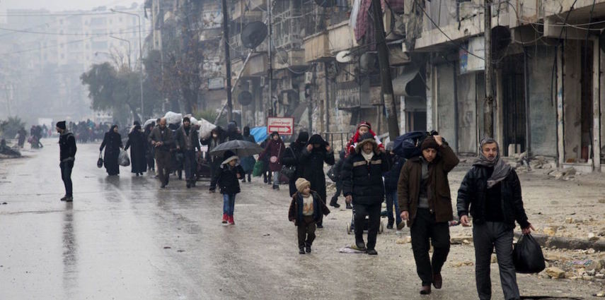 <p>Syrians leave a rebel-held area of Aleppo towards the government-held side on December 13, 2016 during an operation by Syrian government forces to retake the embattled city.<br /> UN chief Ban Ki-moon expressed alarm over reports of atrocities against civilians Monday, as the battle for Aleppo entered its final phase with Syrian government forces on the verge of retaking rebel-held areas of the city.</p> <p> / AFP / KARAM AL-MASRI        (Photo credit should read KARAM AL-MASRI/AFP/Getty Images)</p>